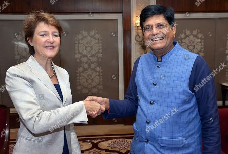 Stock Photo of Swiss federal councillor Simonetta Sommaruga (L) shakes hands with Indian Union Minister for Railway Piyush Goel in New Delhi, India, 21 October 2019. Swiss Federal Councillor Simonetta Sommaruga is on her official visit to India and scheduled to meet the India railway minister and minister of Power to India.