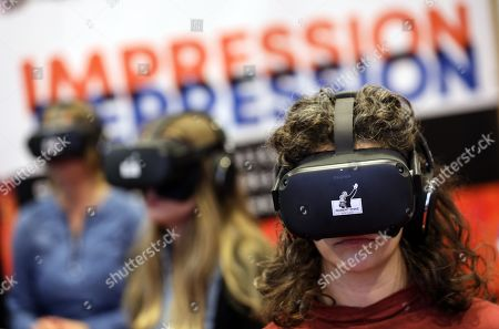 A group of volunteers try a virtual reality experience during the presentation of an awareness campaign on depression by the Robert-Enke Foundation, in Berlin, Germany, 21 October 2019. On the 10th anniversary of the death of the former goalkeeper of the German national squad, the Robert-Enke Foundation starts a nationwide information campaign on depression as a disease.