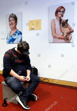 A volunteer tries a virtual reality experience during the presentation of an awareness campaign on depression by the Robert-Enke Foundation, in Berlin, Germany, 21 October 2019. On the 10th anniversary of the death of the former goalkeeper of the German national squad, the Robert-Enke Foundation starts a nationwide information campaign on depression as a disease.