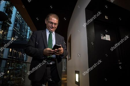 Brexit Steering Group member Philippe Lamberts checks his phone at the European Parliament in Strasbourg, eastern France, Monday Oct.21, 2019. The EU parliament is awaiting approval of the Brexit deal in the House of Commoms which could come in the next hours or days. After that, the EU could move speedily