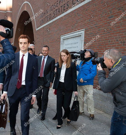 Former Pimco CEO Douglas Hodge (C) leaves the Moakley Federal Courthouse with his attorneys in Boston, Massachusetts, USA, 21 October 2019. According to reports, Hodge pleaded guilty for paying to have his children admitted to university as a fake athletics students in the College Admissions Scandal.