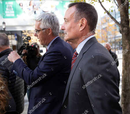 Former Pimco CEO Douglas Hodge (R) leaves the Moakley Federal Courthouse with his attorneys in Boston, Massachusetts, USA, 21 October 2019. According to reports, Hodge pleaded guilty for paying to have his children admitted to university as a fake athletics students in the College Admissions Scandal.