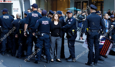 Police arrest New York City politician Melissa Mark-Viverito and a group of protesters from the Puerto Rican community and other organizations after blocking the street during a rally in front of the Museum of Modern Art calling for the removal of businessman Steven Tananbaum from the museum's board of directors in New York, New York, USA, 21 October 2019. Protestors were calling for Tananbaum's removal due to his company, GoldenTree Asset Management, financially benefitting from Puerto Rico's debt crisis, which sprung from damage to the island's economy after Hurricane Maria in 2017.