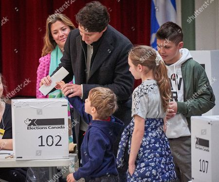 Canadian Prime Minister and Liberal Party leader Justin Trudeau casts his vote with his family Sophie Gregoire (L) his daughter Ella Grace (C) and his sons Xavier (R) and Hadrien at the polling station during the country's 43rd general election day in Montreal, Quebec, Canada, 21 October 2019.