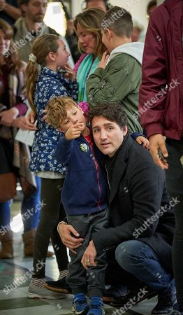 Canadian Prime Minister and Liberal Party leader Justin Trudeau (R) with his wife Sophie Gregoire signs with their children's Ella Grace, Xavier, and Hadrien at the polling station during the country's 43rd general election day in Montreal, Quebec, Canada, 21 October 2019.