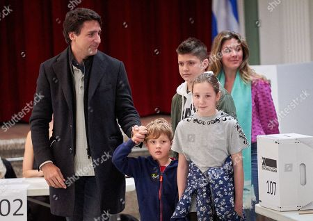 Canadian Prime Minister and Liberal Party leader Justin Trudeau casts his vote with his family  Sophie Gregoire his daughter Ella Grace (C) and his sons Xavier (R) and Hadrien (little) at the polling station during the country's 43rd general election day in Montreal, Quebec, Canada, 21 October 2019.
