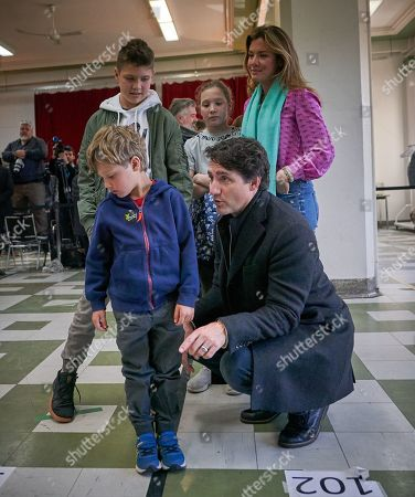 Canadian Prime Minister and Liberal Party leader Justin Trudeau wait in line with his family wife Sophie Gregoire with their children Ella Grace, Xavier, and Hadrien at the polling station during the country's 43rd general election day in Montreal, Quebec, Canada, 21 October 2019.