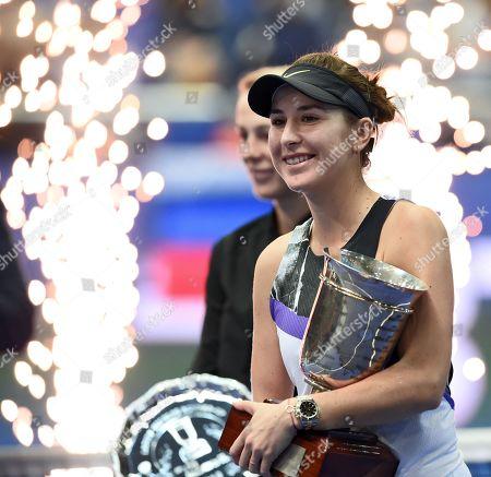 Stock Image of Belinda Bencic of Switzerland celebrates with the trophy