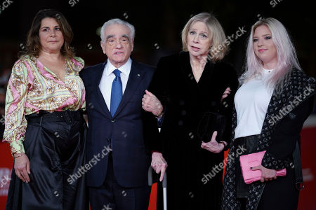 """Director Martin Scorsese, second from left, his wife Helen Morris, second from right, and his daughters Catherine, left, and Francesca pose on the red carpet of the movie """"The Irishman"""", at the Rome Film Fest, in Rome"""