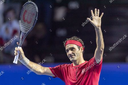 Switzerland's Roger Federer cheers after winning his first round match against Germany's Peter Gojowczyk at the Swiss Indoors tennis tournament in Basel, Switzerland, 21 October 2019.