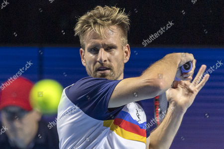 Germany's Peter Gojowczyk in action during his first round match against Switzerland's Roger Federer at the Swiss Indoors tennis tournament in Basel, Switzerland, 21 October 2019.