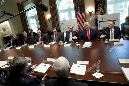 United States President Donald Trump, center, speaks during a Cabinet Meeting at the White House Pictured from left to right: acting Director, Office of Management and Budget (OMB) Russell Vought, US Secretary of Education Betsy DeVos, US Secretary of the Interior David Bernhardt, Administrator of the United States Environmental Protection Agency Andrew Wheeler, US Secretary of Health and Human Services (HHS) Alex Azar, The President, and US Secretary of State Mike Pompeo.