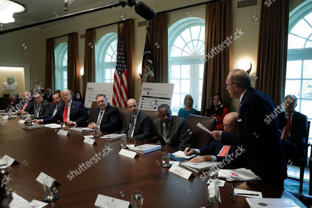 Director of the National Economic Council Larry Kudlow talks to United States President Donald Trump during a Cabinet Meeting at the White House Pictured from left to right: US Secretary of Education Betsy DeVos, US Secretary of the Interior David Bernhardt, Administrator of the US Environmental Protection Agency Andrew Wheeler, US Secretary of Health and Human Services (HHS) Alex Azar, The President, US Secretary of State Mike Pompeo, US Secretary of Labor Eugene Scalia, US Secretary of Housing and Urban Development (HUD) Ben Carson, US Secretary of Commerce Wilbur Ross, Jr. and Kudlow.