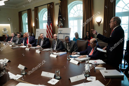 Stock Photo of Director of the National Economic Council Larry Kudlow talks to United States President Donald Trump during a Cabinet Meeting at the White House Pictured from left to right: US Secretary of Education Betsy DeVos, US Secretary of the Interior David Bernhardt, Administrator of the US Environmental Protection Agency Andrew Wheeler, US Secretary of Health and Human Services (HHS) Alex Azar, The President, US Secretary of State Mike Pompeo, US Secretary of Labor Eugene Scalia, US Secretary of Housing and Urban Development (HUD) Ben Carson, US Secretary of Commerce Wilbur Ross, Jr. and Kudlow.