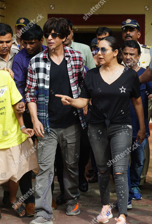 Shah Rukh Khan and his wife Gauri Khan pose after casting vote for Maharashtra State Assembly Elections at Mount Merry school Bandra. Voting took place for the 288-member Maharashtra Assembly. The results will be declared on October 24, 2019.