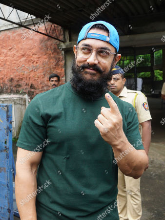 Stock Photo of Aamir Khan poses after casting vote for Maharashtra State Assembly Elections at St. Annes school Bandra. Voting took place for the 288-member Maharashtra Assembly. The results will be declared on October 24, 2019.