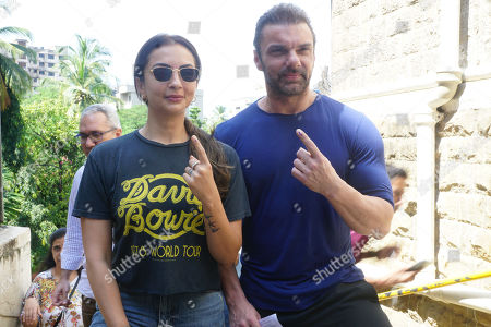 Stock Photo of Sohail Khan and his wife Seema Khan pose after casting votes for Maharashtra State Assembly Elections at St. Annes school Bandra. Voting took place for the 288-member Maharashtra Assembly. The results will be declared on October 24, 2019.