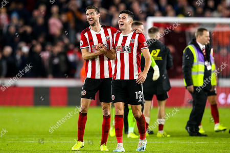 Chris Basham of Sheffield United and John Egan of Sheffield United celebrate victory over Arsenal