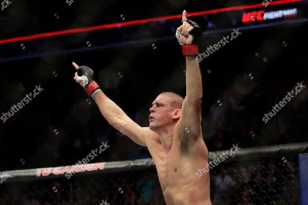 Stock Photo of Joe Lauzon celebrates his victory over Jonathan Pearce during a lightweight mixed martial arts bout, at UFC Fight Night in Boston