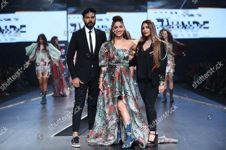 Fashion designer duo Falguni and Shane Peacock with Yami Gautam on the catwalk