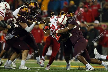 Nebraska running back Maurice Washington, center, tries to break through the tackle of Minnesota linebacker Thomas Barber during the second half of an NCAA college football game in Minneapolis. Washington is not with the team and will not play in the Cornhuskers' home game against Indiana on . Coach Scott Frost announced Washington's status Monday, Oct. 21, 2019, stopping short of calling it a suspension