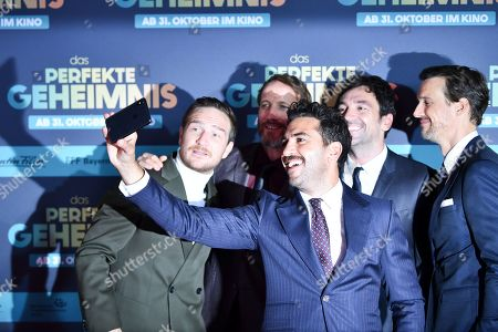 Frederick Lau, Wotan Wilke Moehring, Elyas M'Barek, director Bora Dagtekin and actor Florian David Fitz pose for a selfie on the red carpet before the premiere of 'Das perfekte Geheimnis' (lit.: The perfect secret) in Munich, Germany, 21 October 2019. The movie will be shown in German cinemas from 31 October 2019 on.