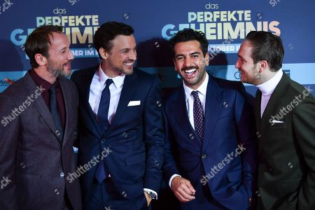 Wotan Wilke Moehring, Florian David Fitz, Elyas M'Barek and Frederick Lau pose on the red carpet before the premiere of 'Das perfekte Geheimnis' (lit.: The perfect secret) in Munich, Germany, 21 October 2019. The movie will be shown in German cinemas from 31 October 2019 on.