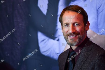 Wotan Wilke Moehring poses on the red carpet before the premiere of 'Das perfekte Geheimnis' (lit.: The perfect secret) in Munich, Germany, 21 October 2019. The movie will be shown in German cinemas from 31 October 2019 on.