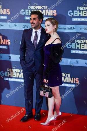 Stock Image of Elyas M'Barek (L) and Jella Haase pose on the red carpet before the premiere of 'Das perfekte Geheimnis' (lit.: The perfect secret) in Munich, Germany, 21 October 2019. The movie will be shown in German cinemas from 31 October 2019 on.