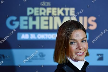 Jessica Schwarz poses on the red carpet before the premiere of 'Das perfekte Geheimnis' (lit.: The perfect secret) in Munich, Germany, 21 October 2019. The movie will be shown in German cinemas from 31 October 2019 on.