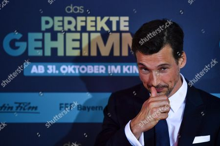 Florian David Fitz poses on the red carpet before the premiere of 'Das perfekte Geheimnis' (lit.: The perfect secret) in Munich, Germany, 21 October 2019. The movie will be shown in German cinemas from 31 October 2019 on.