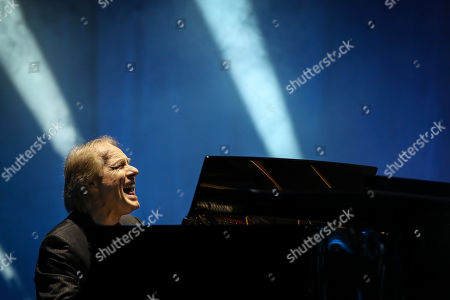 Stock Picture of French pianist Richard Clayderman plays the piano during a concert at the Coliseu dos Recreios in Lisbon, Portugal, 21 October 2019.