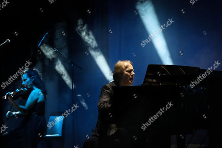 French pianist Richard Clayderman (R) plays the piano during a concert at the Coliseu dos Recreios in Lisbon, Portugal, 21 October 2019.