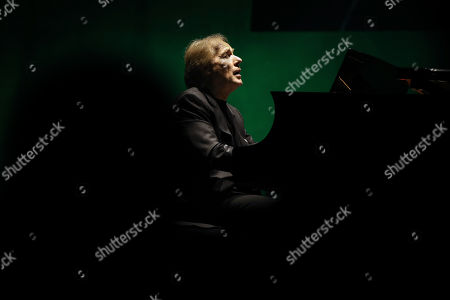 Stock Image of French pianist Richard Clayderman plays the piano during a concert at the Coliseu dos Recreios in Lisbon, Portugal, 21 October 2019.