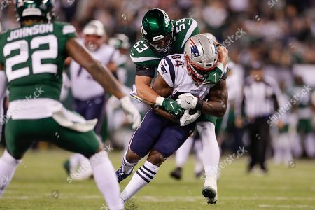 New York Jets' Blake Cashman (53) tackles New England Patriots' Benjamin Watson (84) during the first half of an NFL football game, in East Rutherford, N.J