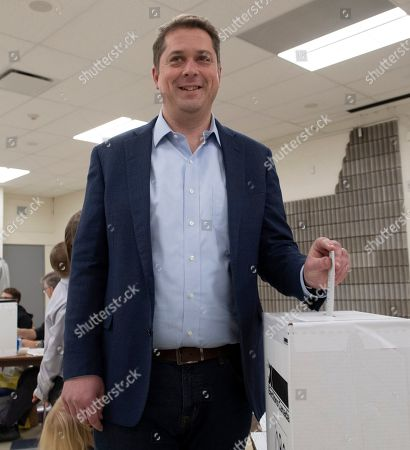Conservative leader Andrew Scheer pauses for cameras as he casts his vote at a polling station in his riding in Regina, Saskatchewan, Canada, 21 October 2019. Canadians are voting in the country's 43rd federal election this day.