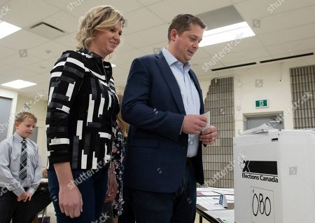 Conservative leader Andrew Scheer (R) and his wife Jill Scheer wait to cast their ballots at a polling station in his riding in Regina,  Saskatchewan, Canada, 21 October 2019. Canadians are voting in the country's 43rd federal election this day.