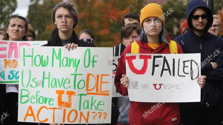 From left, Morgan Werder and Piper Salazar gather with other University of Utah students who walked out of classes, in Salt Lake City, in a show of solidarity to call attention for increased campus safety and protest the school's response after a student was murdered on campus last year. The students walked out of class the day before the one-year anniversary of a student's death, marking the latest sign of continuing fallout over the slaying of Lauren McCluskey by her ex-boyfriend