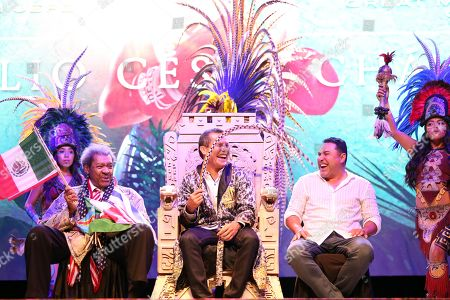 Former Mexican boxer Julio Cesar Chavez (C) participates in a ceremony where he was named as Nojoch jalach, Big maya boss, accompanied by US promoter Don King (L) and former Mexican boxer Oscar de las Hoya (R) during the opening of the 57th Annual Convention of World Box Council, in Cancun, Mexico, 21 October 2019.
