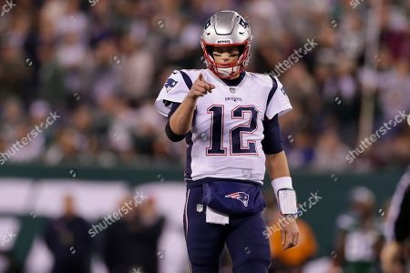 New England Patriots quarterback Tom Brady (12) points to Benjamin Watson (84) after a play during the first half of an NFL football game against the New York Jets, in East Rutherford, N.J