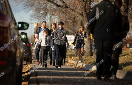 Canadian Conservative Party leader Andrew Scheer (2-L) and his family arrive at a voting station in Regina, Canada, 21 October 2019.