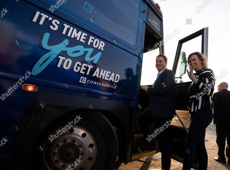 Canadian Conservative Party leader Andrew Scheer (C) boards his touring bus with his family outside a voting station after placing his ballot, in Regina, Canada, 21 October 2019.