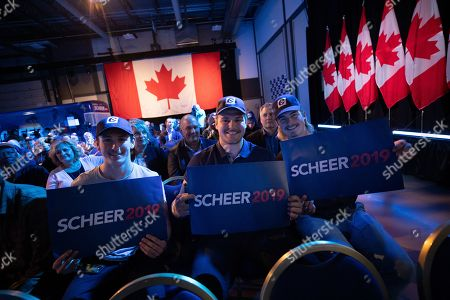 Stock Picture of Supporters of Canadian Conservative Party leader Andrew Scheer, pose for a photo while waiting for election results at the party's headquarters in Regina, Canada, 21 October 2019.