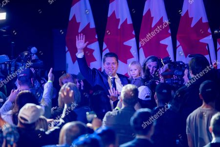 Canadian Conservative Party leader Andrew Scheer (C) greets supporters in Regina, Canada, 21 October 2019.  Liberal Party leader Justin Trudeau has retained his position as Canadian Prime Minister in the federal election but will be forced to form a minority.