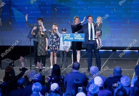 Stock Image of Canadian Conservative Party leader Andrew Scheer (2-R) and his family wave to supporters in Regina, Canada, 21 October 2019.  Liberal Party leader Justin Trudeau has retained his position as Canadian Prime Minister in the federal election but will be forced to form a minority.