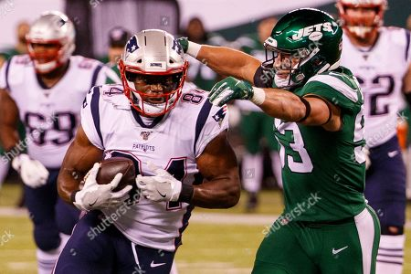 , 2019, New England Patriots tight end Benjamin Watson (84) with the catch as New York Jets linebacker Blake Cashman (53) reaches for him during the NFL game between the New England Patriots and the New York Jets at MetLife Stadium in East Rutherford, New Jersey