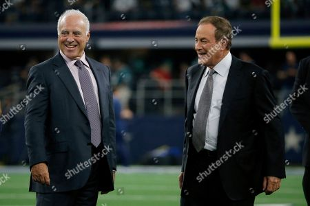 Stock Photo of Jeffrey Lurie, Al Michaels. Philadelphia Eagles owner Jeffrey Lurie and broadcast personality Al Michaels talks during warmups before an NFL football game against the Dallas Cowboys in Arlington, Texas