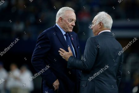 Stock Image of Jeffrey Lurie, Jerry Jones. Dallas Cowboys owner Jerry Jones and Philadelphia Eagles owner Jeffrey Lurie, right, talk during warmups before an NFL football game in Arlington, Texas