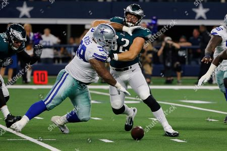 Jason Kelce, Antwaun Woods. Dallas Cowboys defensive tackle Antwaun Woods, left, and Philadelphia Eagles center Jason Kelce (62) compete for a Eagles fumble during an NFL football game in Arlington, Texas, . The Cowboys recovered the fumble