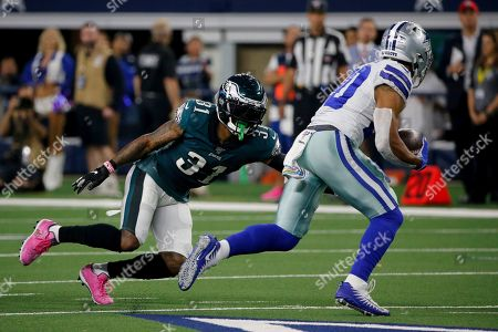 Jalen Mills, Tony Pollard. Philadelphia Eagles cornerback Jalen Mills (31) gives chase as Dallas Cowboys' Tony Pollard (20) carries the ball during an NFL football game in Arlington, Texas